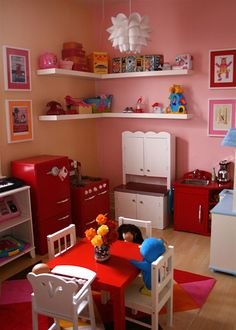Red retro kitchen (Pottery Barn) and cute playroom set up Play Kitchens, Kids Play Corner, Pottery Barn Kitchen, Wooden High Chairs, Corner House, Room Corner, Kitchen Corner, Red Kitchen, Toddler Playroom