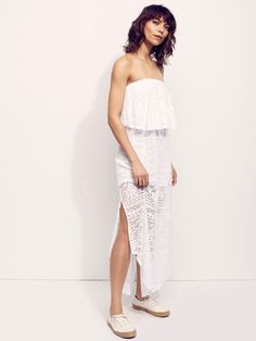Walk This Way Tube Dress | In a sheer cotton crochet this maxi dress is in a strapless silhouette with a femme overlay along the bust with an elastic band for an easy fit. Rounded hem with side vent detailing and an open cutout in back. Lined with a half-slip.