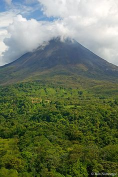 Arenal Volcano has been producing ash columns, massive explosions and glowing red lava flows almost daily since 1968.    La Fortuna / Arenal, Costa Rica