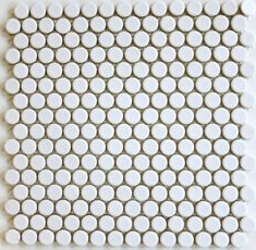 ModDotz Marshmallow Tile Penny Rounds - ModDotz Marshmallow is a white high fired glazed porcelain penny round tile that's fresh and modern with a nod to retro style. Our penny round tile is ideal for any application including kitchen backsplash tile, bathroom tile, floor tile, fireplace tile and pool tile. ModDotz penny tiles measure 19mm and come on mesh mounted sheets. Easy to install in wet areas as well as dry, and well-suited for interior tile and exterior tile applications.