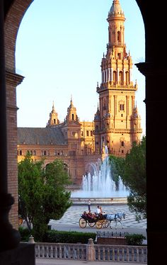 Seville, Spain~ I've ALWAYS wanted to go to Spain! I'd love to be in front of THAT window to look  at that view. I'd love to go to Seville, Madrid, Barcelona in Spain! <3