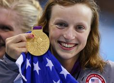 Katie Ledecky of the U.S. poses with her gold medal after winning the women's 800m freestyle final during the London 2012 Olympic Games at the Aquatics Centre
