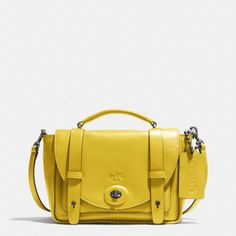 The Bleecker Mini Brooklyn Messenger Bag In Leather from Coach  -  yellow but avail in other colors.  crossbody, structured, cute!  want for summer!     lj
