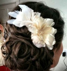 Curled updo with a fun flower piece