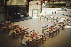 How fun! A wedding reception in an airplane hangar!