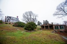 The property's two-bedroom guest cabin dates to the 1940s. A sweet, rustic building, it has pitched wood ceilings, a stone fireplace and windows facing the bay. Ryan Conaty for the New York Times