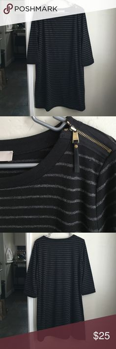 Loft sweater dress Black and grey striped dress.  Slightly thicker material makes it perfect for fall and winter! Pretty good zipper with leather fringe on the left shoulder. Only worn a few times- excellent condition with no defects!  Size tag came off but it is a L! LOFT Dresses