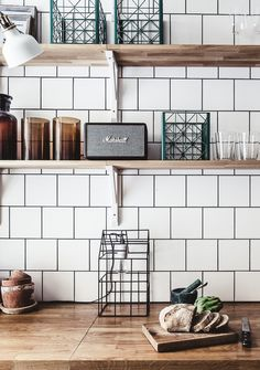Perfect open shelves in the kitchen on white tiles. Love the wood shelves - 1st street