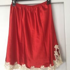 """Victoria's Secret Red  Half Slip This sexy slip is red""""  satin like"""" polyester with creme colored lace trim around the bottom. It is in brand new, never worn condition. You will love it! Victoria's Secret Intimates & Sleepwear Chemises & Slips"""