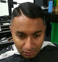 Parted Comb over style, level 1 fade on the side..