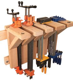 These sturdy 12-in x 16-in brackets are great for storing lots of long heavy clamps in a narrow space. The 2x4 brackets are wide enough for pipe and bar clamps. Use 2x6s to store K-body-style and deep throated adustable clamps.  Dado a 45-degree support board into each bracket. Screw the brackets to the cleats from the back, leaving 2-in spaces between for the clamp's bars. Then fasten the brackets to the wall.