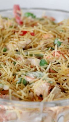 Recipe with video instructions: How to make a Brazilian chicken salad with mayo.  Ingredients: 1 skinless chicken breast, 1 minced onion, 1 small red bell pepper in strips, 1 small green bell pepper in strips, 2 minced stalks of celery, ½ cup of green peas, 1 grated carrot, Minced parsley, 1 cup of mayo, 1 cup of plain yogurt, 1 cup of straw potatoes, Salt, Black pepper