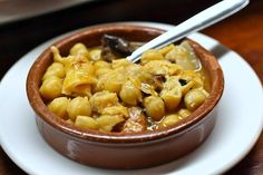 This callos stew, served in a clay dish, is the ultimate cold weather tapa and a beautiful choice if you're looking for typical foods in Madrid