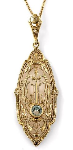 Art Deco Aquamarine Pendant Necklace.  A single pale blue aquamarine gleams from within this striking and unusual Art Deco pendant necklace, die-struck and hand finished in rich 14K yellow gold - circa 1930s. Fanciful foliate and geometric filigree coalesce for an enchanting neoclassical effect. 1 and 7/8 inch from the top of the loop, the chain measures 18 inches. #goldnecklace