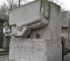 Oscar Wilde's Grave! And the amazing pere lechaise cemetery - did a literary walking tour of Paris (with a book for guide!)