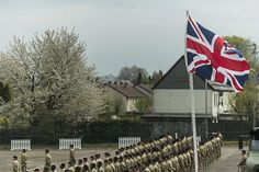 The Union Flag flys high over a medal parade for troops of 7 Regiment, Royal Logistic Corps at Bielefeld, Germany.