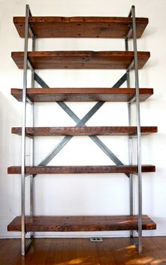 Beautiful industrial style shelving unit. Hand-made, American steel frame. Wood is reclaimed Douglas Fir from a 150 year old restaurant and hotel that was recently torn down in Downtown Los Angeles. Exceptionally beautiful wood, harvested before chainsaws and power tools. The wood has been sanded to a luster and finished with an all natural, non-toxic, wax and Danish oil combination; care has been taken to preserve the ax marks and other signs of character. $675. www.everydayheaven.org