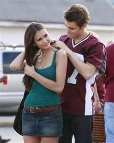 I totally love the teal tank and mini jean skirt that Elena is rocking in season 1!