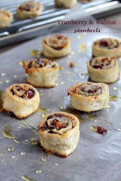Cranberry and Walnut Pinwheels~ Ingredients: 1 cup dried cranberries, 1 cup chopped walnuts, 1/2 cup sugar, zest of 1 orange, 2 refrigerated pie crusts, 2 tablespoons butter, melted, 1 whole egg, 2 tablespoons water, honey.