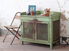 Do you have space for this wonderful mid-sized vintage green cupboard? The mesh-covered internal storage area and the table-top surface make this bright cabinet a functional piece of vintage furniture for kitchens, bedrooms and living rooms. #kitcheninspo #kitchenfurniture #vintagekitchen #woodenfurniture #kitchenstorage #wallcabinet #greenfurniture