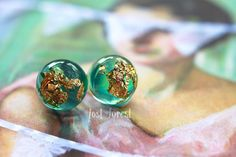 A welcome return of the 'Woodland Dew Drop' earrings! These little sparkling eco resin studs are the perfect accessory this season; with a glamorous fusion of aqua tinted resin and shimmering gold leaf. I have a limited amount in store now, so grab a pair before they're gone!