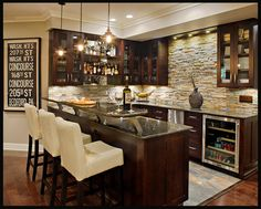 Basement bar idea. Love the stone, the combo of stainless steel and espresso color. Also interesting addition to the countertop.