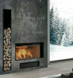 The fireplace is definitely asymmetrical with the way the wood acts as decor and function. Fireplace Tv Wall, Concrete Fireplace, Stove Fireplace, Modern Fireplace, Living Room With Fireplace, Fireplace Surrounds, Future House, My House, Contemporary Fireplace Designs