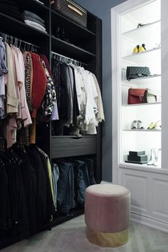 Beautiful walk-in-closet with a pink velvet pouf & backlight for the bag collection