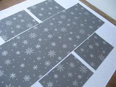 Běhoun vánoční-Stříbrné vločky vánoční běhoun 152cmx51cm,nádherná silnější bavlněná látka se stříbrným potiskem,vyšší gramáž-180g/m.Možno na přáníušít i v jiné velikosti,také jako středový ubrus,prostírání nebo ubrus na celý stůl v jakémkoli tvaru.V mé nabídce rovněž vánoční polštář ve stejném designu.