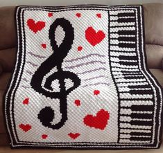 Handmade Corner to Corner Crochet Musical Blanket Crocheted in 8 Ply Needles Acrylic Yarn Size Approx Width 113 cm X Length 147 cm (45 inch X 58 inch) Pattern purchased from Etsy shop, CrochetC2CLily Handcrafted by Valerie