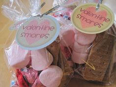 "Smores Goody Bags- just throw marshmallows, graham crackers, and Valentine Hershey kisses into a goody bag.   Add a cute saying on the label like...  ""Every Day I Like You Smore!"""