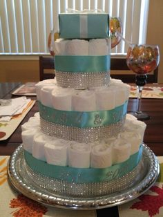 For a fun baby shower gift idea - try making one of these awesome diaper cakes. Baby Girl Shower Themes, Baby Shower Fun, Baby Shower Gifts, Tiffany & Co., Tiffany Theme, Diy Diaper Cake, Nappy Cake, Tiffany Baby Showers, Elephant Diaper Cakes