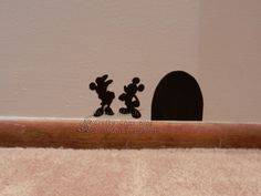 I made a mouse hole with vinyl and added Minnie and Mickey next to it.  I have this in my hallway, just outside my craft room