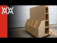 Here's a rolling cart for storing lumber, plywood, and other sheet goods in your workshop. I made this to take up as little space as possible, yet hold a lot of wood. Download free plans for this project: http://www.woodworkingformeremortals.com/2013/01/make-rolling-lumber-cart.html ---------------- Woodworking For Mere Mortals. Easy woodwor...