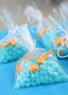 Goldfish frackers and jellybeans favors for an Under The Sea birthday party for kids birthday Two Easy Kids Party Ideas: Into The Woods & Under The Sea Mermaid Theme Birthday, Little Mermaid Birthday, Little Mermaid Parties, Mermaid Party Favors, Fish Party Favors, Mermaid Themed Party, Fish Party Decorations, Swimming Party Favors, Moana Birthday Party Theme