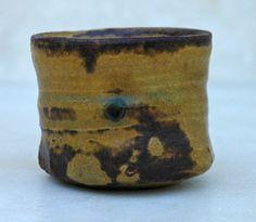 "Ki-Seto guinomi by Kagami Masakane  Guinomi is often called a miniature chawan. Every part of it, like the kodai (the foot), kuchizukuri (the lip), and koshi (the hips), is difficult to make ""  Guinomi are sake cups, actually 'one gulp' sake cups. bigger than the usual sake cups"