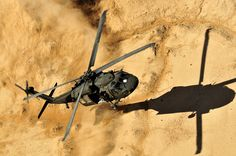 Members of a UH-60 Black Hawk helicopter crew, assigned to 2nd Battalion, 25th Aviation Regiment, 25th Combat Aviation Brigade, come in for a dust landing