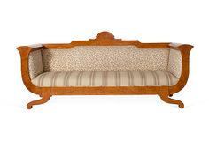 the wood of this couch is like a picture frame & I love the Egyptian flair