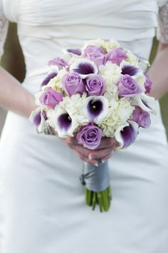 purple rose n calla lily wedding flower bouquet, bridal bouquet, wedding flowers, add pic source on comment and we will update it. www.myfloweraffair.com can create this beautiful wedding flower look.