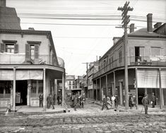 "New Orleans circa 1906. ""Italian headquarters, Madison Street."""