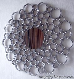 Make a sequined starburst mirror!  This is incredible..made with cardboard rings, a tin lid, mirror and sequins!