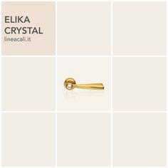 Elika Crystal | Elusive lines give an unexpected dynamic to the formal shapes, made even more surprising by the light released by the Swarovski® crystal - - - Linee sfuggenti donano un'inaspettata dinamicità alle importanti forme, rese ancor più sorprendenti dalla luce emanata da un cristallo Swarovski®. #handles #doorhandle #doorhandles #lineacali #maniglie #round #crystal #swarovski #brass #klamki #ручки #manillas #klinken