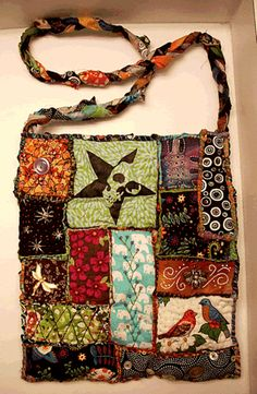 Teesha Moore bag. I like this. It's silly, unique, playful, and a great way to use old t-shirts, blankets, and spare cloth that I really like.