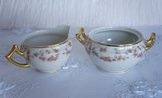 Beautiful pink floral sugar&creamer set by Limoges. There is no gold loss, chips or repairs just some crazing on the bottom of the creamer, pretty