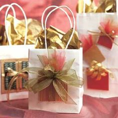 The festive wrapped packages on the outside of these glamorous gift bags promise holiday surprises inside.