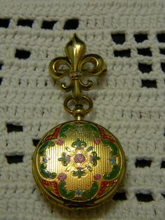 Vintage Fleur de lis watch pin with painted locket. $30.00, via Etsy.