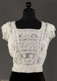 "IRISH CROCHET GARMENTS, 1910  -  Lot: 249 May 9, 2017 - CATALOG SALE Sturbridge, Massachusetts -  blouse, square neckline, cap sleeves & inset W band, B to 38"", W to 28"", L 19"", (2 tiny stains at W) excellent."