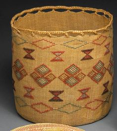 An Aleut polychrome basket  •  Alternating bands of diamond and hourglass motifs, a braided rim band finishing off the top.   height 10in, diameter 11 1/2in
