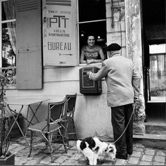 A trip to the post office in Montmartre, where his four-legged companion decides to do his business. Photographed by Sam Presser in the 1960s.