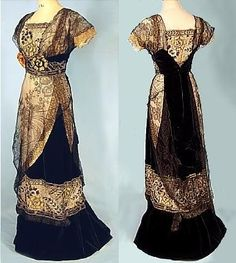 c. 1910 Black Cotton Velvet and Silk Chantilly Lace Edwardian Gown. With slightly raised waist emphasized with wide band, short net sleeves, square neckline, A-line skirt with small train, the bodice sides and part of the skirt overlaid with fine black lace, the center bodice, waist and lower part of skirt further decorated with floral embroidered tulle worked in gold metallic, black and white silks and beads, the lower edge of skirt band trimmed with black fur.
